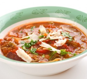 Tasty Minestrone soup in a green bowl.