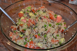 Fresh salad with couscous and selection of peas and vegetables.
